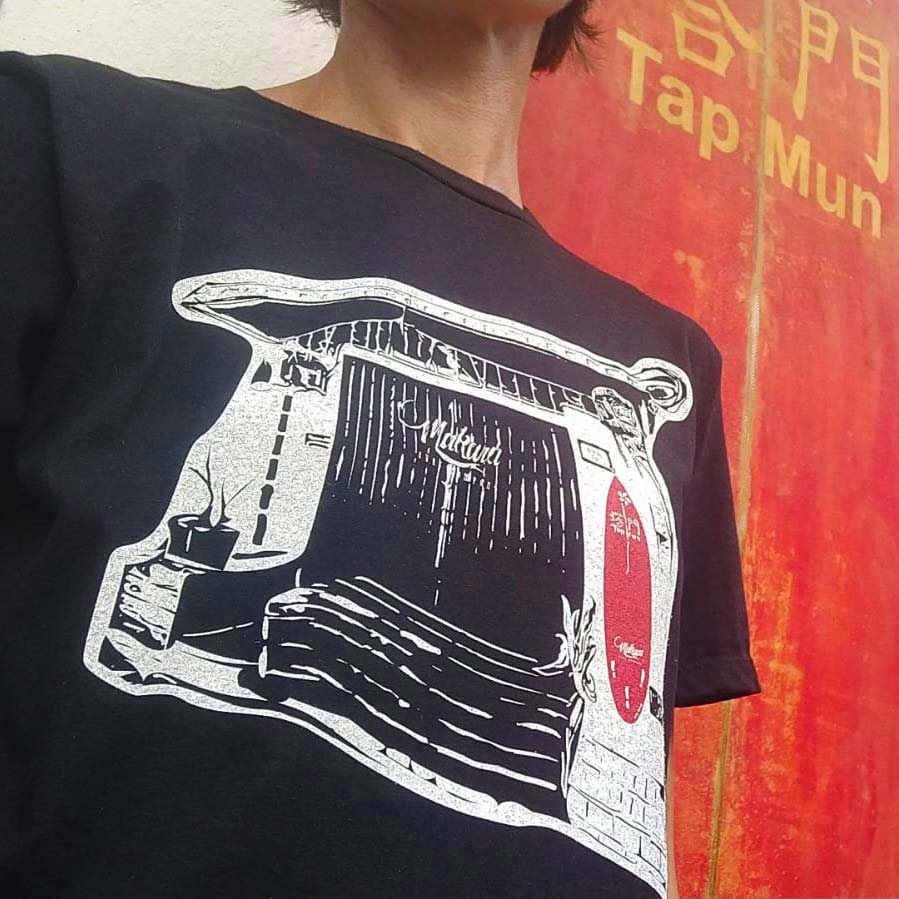 Tap Mun Boardworks Tee Shirt being worn in front of the Tap Mun Boardworks